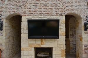 Pool-facing mounted TV